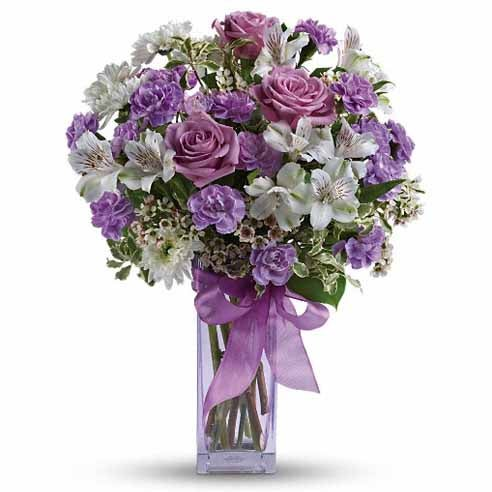 Flower delivery with lavender carnations and light purple roses and cheap flowers