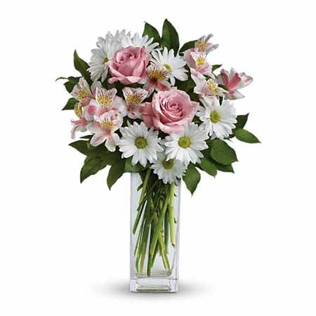 Cheap pale pink rose bouquet with white daisies and cheap flowers in glass vase