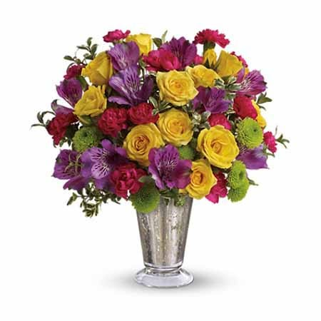 Multicolor flower bouquet of yellow roses, purple alstromeria and sparkle silver vase