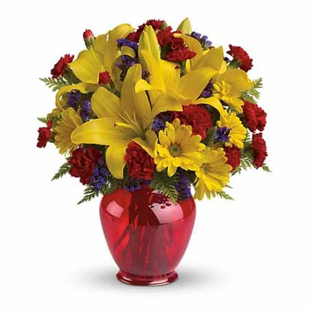 Red carnations and yellow lilies with red ginger jar for cheap flower delivery