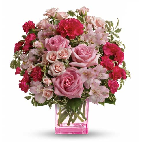 pink roses, pink spray roses, hot pink carnations and soft pink alstroemeria accented with assorted greenery + pink vase