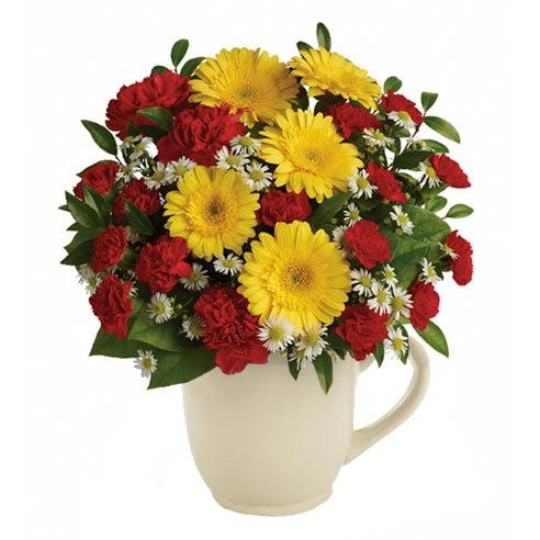 Flowers in a mug with cheap flowers yellow daisies and yellow gerbera daisies