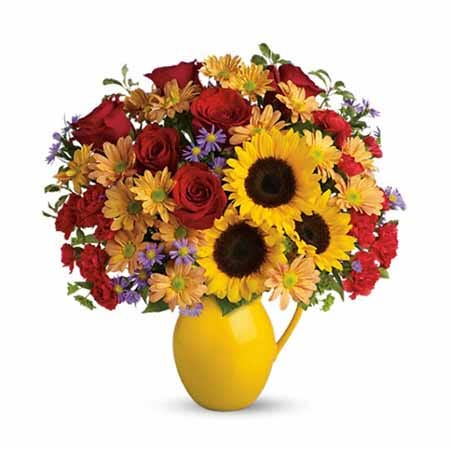Mixed sunflower and red roses bouquet in a yellow pitcher flower bouquet