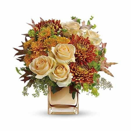 Romantic fall flower bouquet in bronze vase with pale peach roses and mums