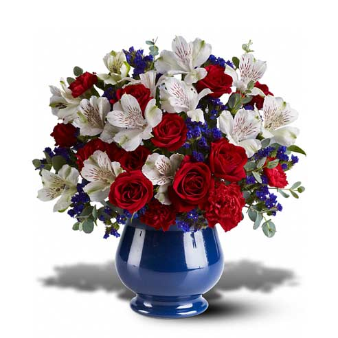 Red roses, white alstroemeria and blue iris in a blue vase