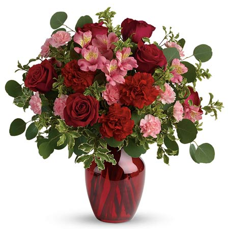 Valentine's Day flower delivery with red roses and carnations and pink alstroemeria