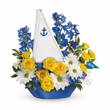 Yellow roses, white daisies and blue delphinium in a boat vase