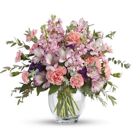 Lavender alstroemeria and pale pink carnations pastel flower bouquet in vase