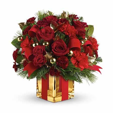 Red roses, red carnations and a gold square vase with a ribbon
